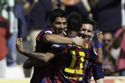 Luis Suarez (L) of FC Barcelona celebrates scoring their fourth goal with teammates Neymar JR. (2ndL) and Lionel Messi (R) during the La Liga match between Cordoba CF and Barcelona FC at El Arcangel stadium on May 2, 2015 in Cordoba, Spain.