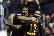 Luis Suarez (L) of FC Barcelona celebrates scoring their fourth goal with team-mates Neymar JR. (2ndL) and Lionel Messi (R) during the La Liga match between Cordoba CF and Barcelona FC at El Arcangel stadium on May 2, 2015 in Cordoba, Spain.
