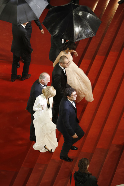 'The Whistlers (La Gomera/ Les Siffleurs)' Red Carpet - The 72nd Annual Cannes Film Festival [the whistlers,red,carpet,umbrella,wedding,fashion,red carpet,formal wear,ceremony,interaction,flooring,agusti villaronga,corneliu porumboiu,vlad ivanov,rodica lazar,l-r,la gomera,red carpet,the 72nd annual cannes film festival,screening]