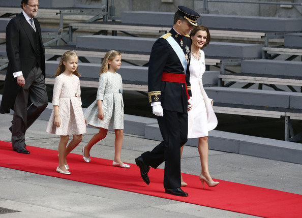 King Felipe VI of Spain and Queen Letizia of Spain arrive followed by  Princess Sofia, Princess Leonor,  Princess of Asturias and Prime Minister Mariano Rajoy at the Lions Gate, the Congress of Deputies during the King's official coronation ceremony on June 19, 2014 in Madrid, Spain. The coronation of King Felipe VI is held in Madrid. His father, the former King Juan Carlos of Spain abdicated on June 2nd after a 39 year reign. The new King is joined by his wife Queen Letizia of Spain.
