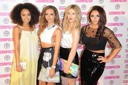 Perrie Edwards, Jesy Nelson, Leigh-Anne Pinnock and Jade Thirlwall attend the Cosmopolitan Ultimate Women of the Year Awards at Victoria & Albert Museum on December 5, 2013 in London, England.