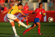 Monica #3 of Brazil passes the ball as Shirley Cruz #10 of Costa Rica defends during the FIFA Women's World Cup 2015 Group E match at Moncton Stadium on June 17, 2015 in Moncton, Canada.