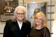 Ricky Skaggs and Charlotte Scott admire Skaggs' plaque at the 2018 Country Music Hall of Fame and Museum Medallion Ceremony honoring inductees Johnny Gimble, Ricky Skaggs and Dottie West at Country Music Hall of Fame and Museum on October 21, 2018 in Nashville, Tennessee.