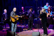 "Nashville Cats member David Briggs, Musician Steve Young , Nashville Cats member Norbert Putnam, Charlie McCoy, Musicians Tracy Nelson, Kenny Malone and Wanda Vick perform during Listen To The Band: The Nashville Cats In Concert With Special Guests For ""Dylan, Cash, And The Nashville Cats"" Exhibition Opening Weekend at the Country Music Hall of Fame and Museum on March 28, 2015 in Nashville, Tennessee."