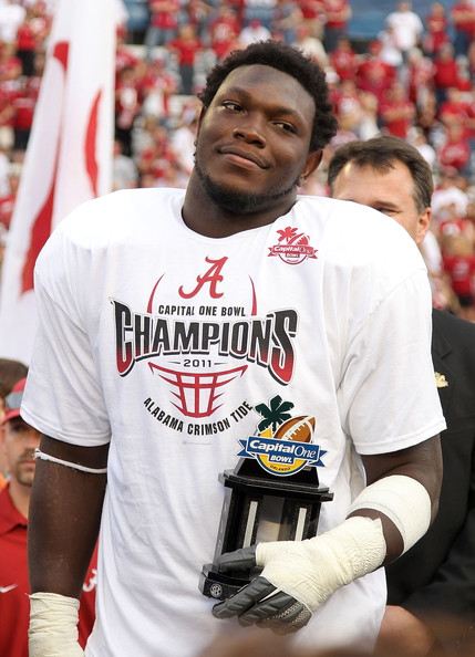 Courtney Upshaw   Courtney Upshaw #41 of the Alabama Crimson Tide accepts the MVP award after winning the Capitol One Bowl against the Michigan State Spartans at the Florida Citrus Bowl on January 1, 2011 in Orlando, Florida.