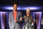 Actor Steve Howey and Optune Patient Ambassador Jennifer Riston walk the runway during the Creative Coalition's 2019 #RightToBearArts Gala Presented By Optune on May 09, 2019 in Washington, D.C.