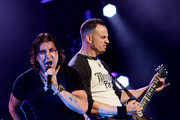 Singer Scott Stapp (L) and guitarist Mark Tremonti of Creed perform at the Wiltern Theatre on May 15, 2012 in Los Angeles, California.