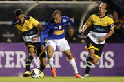 Mayke #22 of Cruzeiro try to pass between Giovanni #6 and #10 Paulo Baier of Criciuma during a match between Criciuma and Cruzeiro as part of Campeonato Brasileiro 2014 at Heriberto Hulse Stadium on August 9, 2014 in Criciuma, Brazil