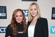 (L-R) Leah Remini, recipient of the Impact Award, and Lisa Kudrow pose in the press room during the Critics' Choice Real TV Awards at The Beverly Hilton Hotel on June 02, 2019 in Beverly Hills, California.