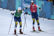 Calle Halfvarsson of Sweden (L) and Marcus Hellner of Sweden handover during the Cross Country Men's Team Sprint Free semi final on day 12 of the PyeongChang 2018 Winter Olympic Games at Alpensia Cross-Country Centre on February 21, 2018 in Pyeongchang-gun, South Korea.
