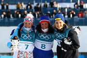 (L-R) Second placed Krista Parmakoski of Finland, first placed Marit Bjoergen of Norway and third placed Stina Nilsson of Sweden celebrate following the Ladies' 30km Mass Start Classic on day sixteen of the PyeongChang 2018 Winter Olympic Games at Alpensia Cross-Country Centre on February 25, 2018 in Pyeongchang-gun, South Korea.