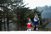 Stina Nilsson of Sweden (19) and Ingvild Flugstad Oestberg of Norway (2) compete during the Ladies' 30km Mass Start Classic on day sixteen of the PyeongChang 2018 Winter Olympic Games at Alpensia Cross-Country Centre on February 25, 2018 in Pyeongchang-gun, South Korea.