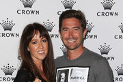 Harry Kewell (R) and his wife Sheree Murphy pose as they arrive at the IMG tennis players party at Crown Towers on January 12, 2014 in Melbourne, Australia.