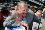 (L-R) Jockey Jim Cassidy is hugged by owner John Singleton after winning the Crown Oaks during the 2012 Crown Oaks Day at Flemington Racecourse on November 8, 2012 in Melbourne, Australia.