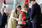 Prince Frederik of Denmark and Crown Princess Mary of Denmark burn incense during a visit at the War Memorial of Korea on May 10, 2012 in Seoul, South Korea. The Crown Prince and Crown Princess of Denmark are on a six-day visit to South Korea.