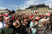 Thousand of Danes and tourists with the flag Dannebrog on the Amalienborg Palace Square during Crown prince Frederik with his family appearance on the balcony of their residence waving to the people on the occasion of his 50th birthday on May 26, 2018 in Copenhagen, Denmark. Later during the evening the Crown Prince host a Gala Banquet at Christiansborg