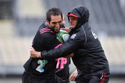 Captain Samuel Whitelock is tackled by Head Coach Scott Robertson during the Crusaders Super Rugby captain's run at AMI Stadium on March 22, 2018 in Christchurch, New Zealand.