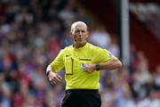 Referee Mike Dean during the Barclays Premier League match between Crystal palace and Burnley at Selhurst Park on September 13, 2014 in London, England.