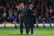 Former Crystal Palace players Mark Bright (L) and Ian Wright (R) are paraded to the fans prior to kickoff during the Barclays Premier League match between Crystal Palace and Fulham at Selhurst Park on October 21, 2013 in London, England.