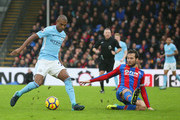 Fernandinho of Manchester City is faced by Yohan Cabaye of Crystal Palace during the Premier League match between Crystal Palace and Manchester City at Selhurst Park on December 31, 2017 in London, England.