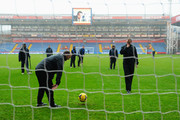 Referee Mike Dean tests the bounce of the ball in the penalty box before the Barclays Premier League match between Crystal Palace and Norwich City at Selhurst Park on January 1, 2014 in London, England.