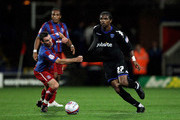 Kanu of Portsmouth has his shirt pulled during the npower Championship match between Crystal Palace and Portsmouth at Selhurst Park on September 14, 2010 in London, England.