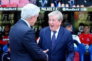 Roy Hodgson, Manager of Crystal Palace and Mark Hughes, Manager of Southampton shake hands ahead of the Premier League match between Crystal Palace and Southampton FC at Selhurst Park on September 1, 2018 in London, United Kingdom.