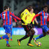 Yohan Cabaye Wilfried Zaha Photos - Abdoulaye Doucoure of Watford is tackled by Yohan Cabaye and Wilfried Zaha of Crystal Palace during the Premier League match between Crystal Palace and Watford at Selhurst Park on December 12, 2017 in London, England. - Crystal Palace v Watford - Premier League
