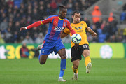 Wilfried Zaha of Crystal Palace is challenged by Jonny of Wolverhampton Wanderers during the Premier League match between Crystal Palace and Wolverhampton Wanderers at Selhurst Park on October 6, 2018 in London, United Kingdom.