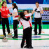 Moe Meguro Photos - Mari Motohashi (2R) of Japan hugs teammate Moe Meguro (C) after defeating Russia, 12-9, during the women's curling round robin game between Japan and Russia on day 10 of the Vancouver 2010 Winter Olympics at Vancouver Olympic Centre on February 21, 2010 in Vancouver, Canada. - Curling - Day 10