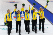 (L-R) Kajsa Bergstroem, Anna Le Moine, Cathrine Lindahl, Eva Lund and Anette Norberg of Sweden celebrate winning the gold medal after their victory over Canada in the women's gold medal curling game between Canada and Sweden on day 15 of the Vancouver 2010 Winter Olympics at Vancouver Olympic Centre on February 26, 2010 in Vancouver, Canada.