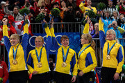 (L-R) Kajsa Bergstroem, Anna Le Moine, Cathrine Lindahl, Eva Lund and Anette Norberg of Sweden celebrate winning their gold medals after victory over Canada in the women's gold medal curling game between Canada and Sweden on day 15 of the Vancouver 2010 Winter Olympics at Vancouver Olympic Centre on February 26, 2010 in Vancouver, Canada.