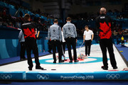 Cameron Smith, Kyle Waddell, Thomas Muirhead and Kyle Smith of Great Britain compete in the Curling Men's Round Robin Session 1 held at Gangneung Curling Centre on February 14, 2018 in Gangneung, South Korea.