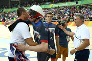 Steven Burke of Team Great Britain celebrates winning the gold medal with team staffs after the Men's Team Pursuit Final for Gold on Day 7 of the Rio 2016 Olympic Games at the Rio Olympic Velodrome on August 12, 2016 in Rio de Janeiro, Brazil.