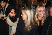 (L-R) Waris Ahluwalia, Meredith Melling Burke and Rebecca Romijn attend the Cynthia Rowley fall 2012 fashion show during Mercedes-Benz Fashion Week at the IAC Building on February 9, 2012 in New York City.