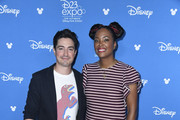Ben Feldman, Aisha Tyler, attend D23 Disney + event at Anaheim Convention Center on August 23, 2019 in Anaheim, California.