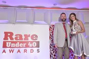 Will Alford, Co-founder of RARE, presents an award to Sadie Robertson during the inaugural DC RARE Under 40 Awards at Hotel Palomar on April 16, 2016 in Washington, DC.