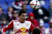 Sacha Kljestan #16 of New York Red Bulls heads the ball in front of Steve Birnbaum #15 of D.C. United during their match at Red Bull Arena on March 22, 2015 in Harrison, New Jersey.