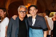 Giuseppe Zanotti and Eugene Tong (R) attend DETAILS Magazine Cocktail Party on June 20, 2015 in Milan, Italy.
