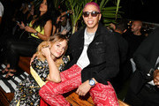 Brandi Cyrus and Purple attend as DIESEL celebrates the exclusive launch of DIESEL Wynwood 28, their first residential building, with a DJ set by Amrit at Barter on December 04, 2019 in Miami, Florida.