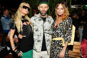 (L-R) Paris Hilton, Stefano Rosso, and Brandi Cyrus attend as DIESEL celebrates the exclusive launch of DIESEL Wynwood 28, their first residential building, with a DJ set by Amrit at Barter on December 04, 2019 in Miami, Florida.