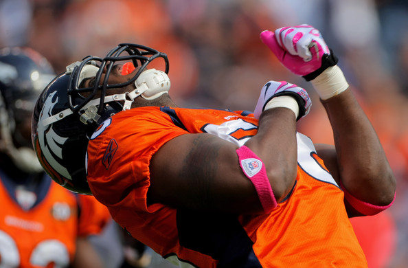 Linebacker Robert Ayers #56 of the Denver Broncos celebrates a defensive play against the <a class='sbn-auto-link' href=