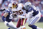 Adrian Peterson #26 of the Washington Redskins gets tackled for a loss of yards by DeMarcus Lawrence #90 of the Dallas Cowboys in the first quarter of the game at FedExField on October 21, 2018 in Landover, Maryland.
