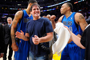Owner Mark Cuban of the Dallas Mavericks celebrates with Tyson Chandler #6 and Shawn Marion #0 after the Mavericks 93-81 victory against the Los Angeles Lakers in Game Two of the Western Conference Semifinals in the 2011 NBA Playoffs at Staples Center on May 4, 2011 in Los Angeles, California. NOTE TO USER: User expressly acknowledges and agrees that, by downloading and or using this photograph, User is consenting to the terms and conditions of the Getty Images License Agreement.