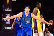 Seth Curry #30 of the Dallas Mavericks celebrates his three pointer in front of Luol Deng #9 of the Los Angeles Lakers during a 101-89 Mavericks win at Staples Center on December 29, 2016 in Los Angeles, California.  NOTE TO USER: User expressly acknowledges and agrees that, by downloading and or using this photograph, User is consenting to the terms and conditions of the Getty Images License Agreement.