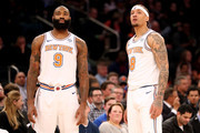 Kyle O'Quinn #9 and Michael Beasley #8 of the New York Knicks have a conversation in the first quarter against the Dallas Mavericks during their game at Madison Square Garden on March 13, 2018 in New York City. NOTE TO USER: User expressly acknowledges and agrees that, by downloading and or using this photograph, User is consenting to the terms and conditions of the Getty Images License Agreement.
