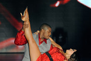 """Actor Kyle Massey (L) and dancer Lacey Schwimmer perform during the grand opening of """"Dancing With the Stars: Live in Las Vegas"""" at the New Tropicana Las Vegas April 13, 2012 in Las Vegas, Nevada."""