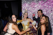 """(L-R) Dancer Lacey Schwimmer, entertainer Joey Fatone and singer/actress Sabrina Bryan pose with a model serving drinks at the after party for the grand opening of """"Dancing With the Stars: Live in Las Vegas"""" at the New Tropicana Las Vegas April 13, 2012 in Las Vegas, Nevada."""