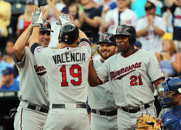 Danny Valencia Danny Valencia #19 of the Minnesota Twins is congratulated by teammates Joe Mauer #7, Jason Kubel #16 and Delmon Young #21 at home plate after hitting a grand slam home run during the 1st inning of the game against the Kansas City Royals on July 26, 2010 at Kauffman Stadium in Kansas City, Missouri.