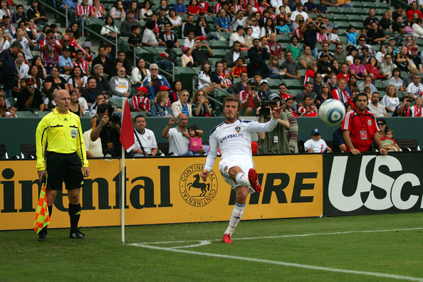 David Beckham David Beckham #23 of the Los Angeles Galaxy takes a corner kick in the first half during the MLS match against Chivas USA at The Home Depot Center on October 3, 2010 in Carson, California. The Galaxy defeated Chivas USA 2-1.